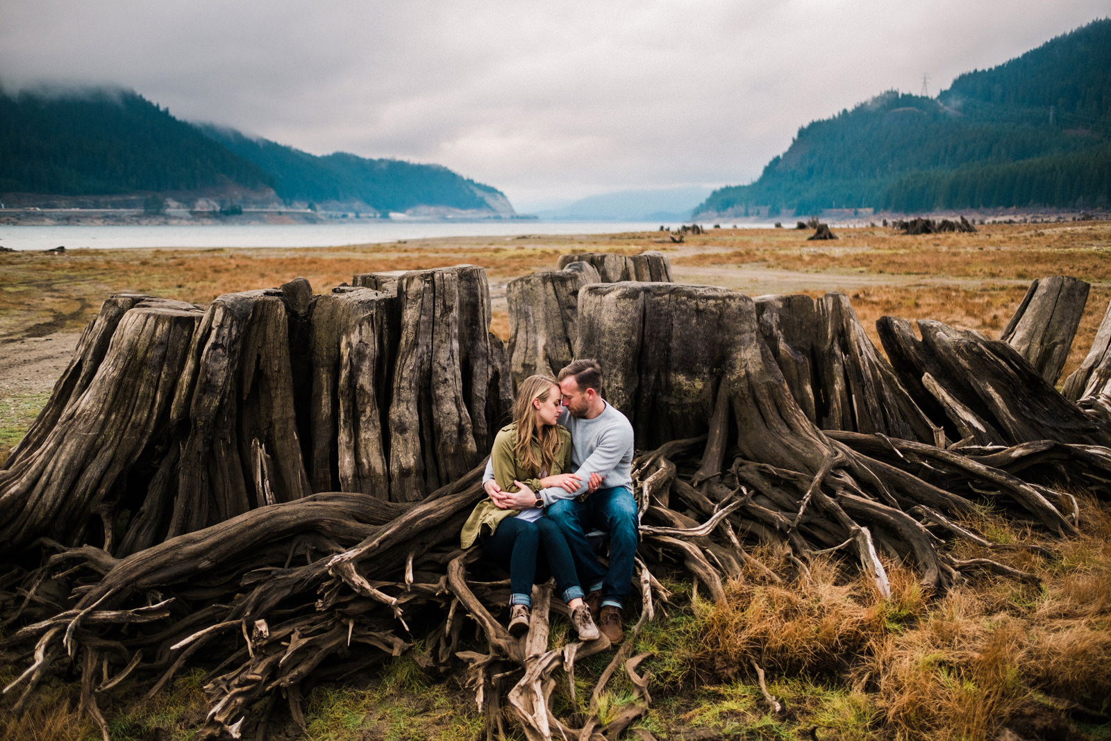 098-snoqualmie-pass-engagement-photo-with-tree-stumps-and-mountain-lakes.jpg