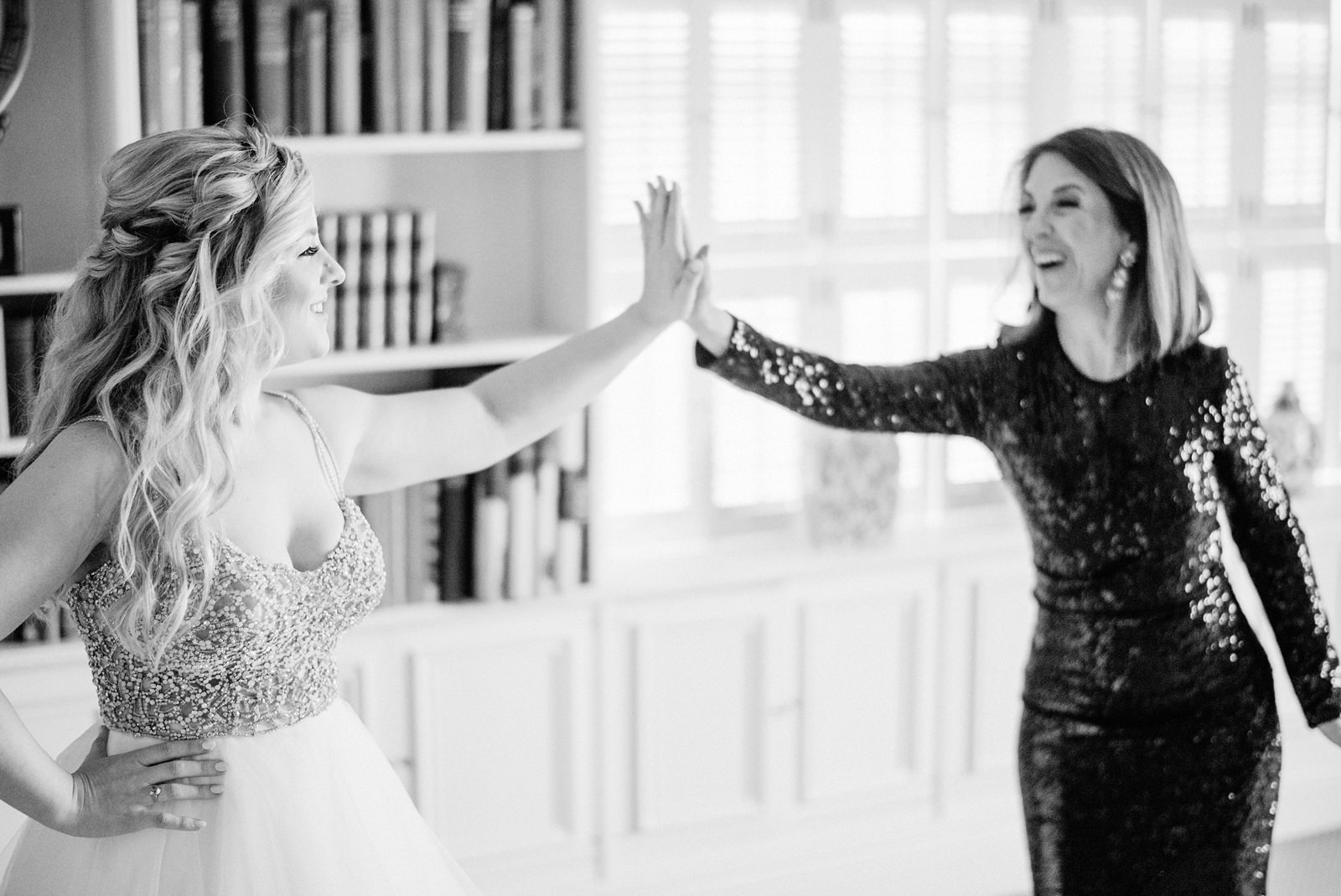 168-bride-and-her-mother-high-fiving-by-washington-documentary-photographer.jpg