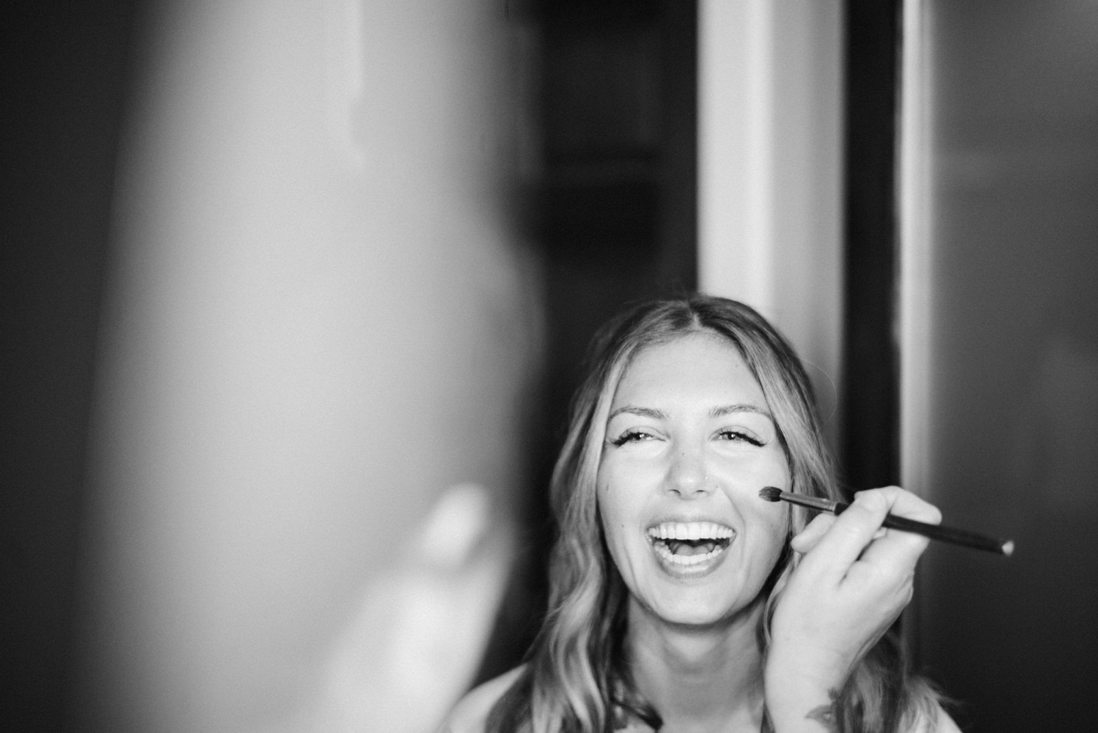 182-happy-bride-getting-ready-at-fireseed-catering-by-washington-wedding-photographer.jpg