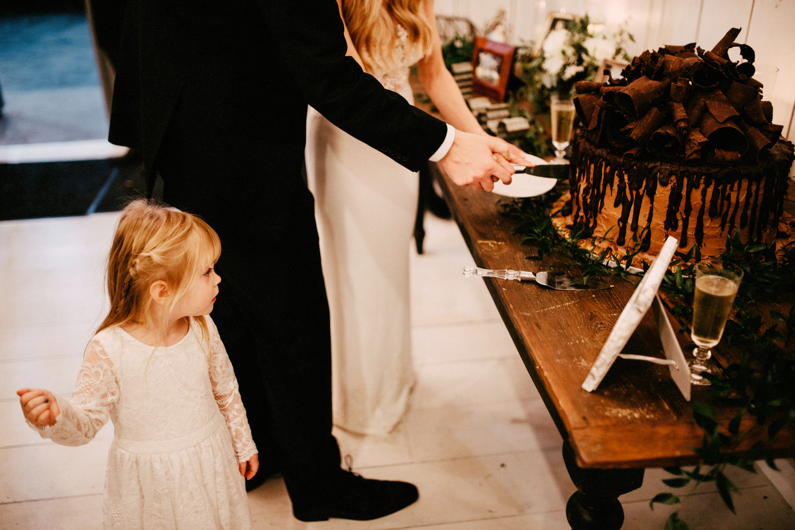 191-flower-girl-watching-cake-cutting-at-the-white-sparrow-barn-by-dallas-wedding-photographer-ryan-flynn.jpg