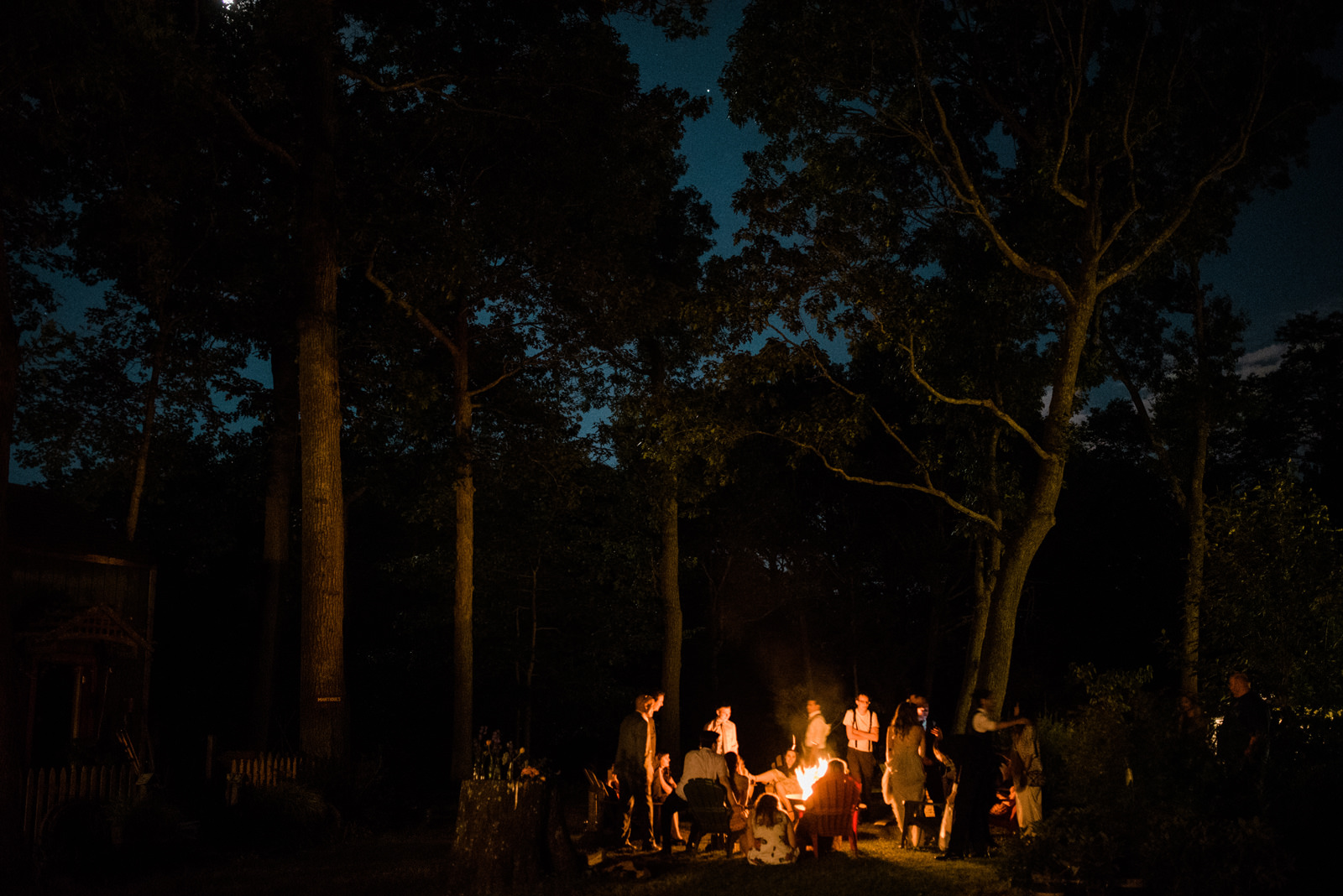207-wedding-party-around-bonfire-at-the-peconic-river-herb-farm-by-brooklyn-photographer.jpg