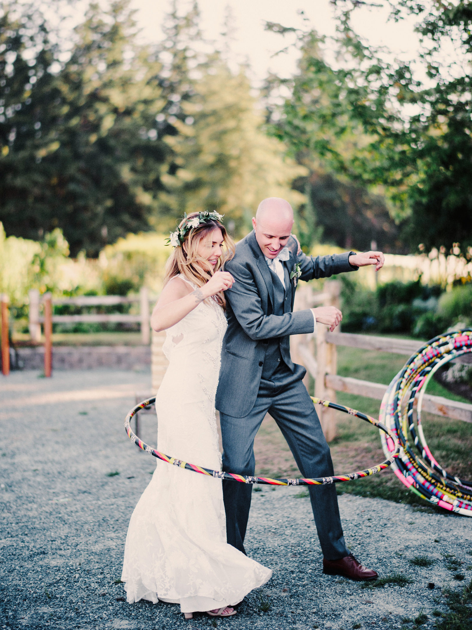 217-bride-and-groom-hula-hooping-at-fireseed-catering-by-best-seattle-film-photographer.jpg