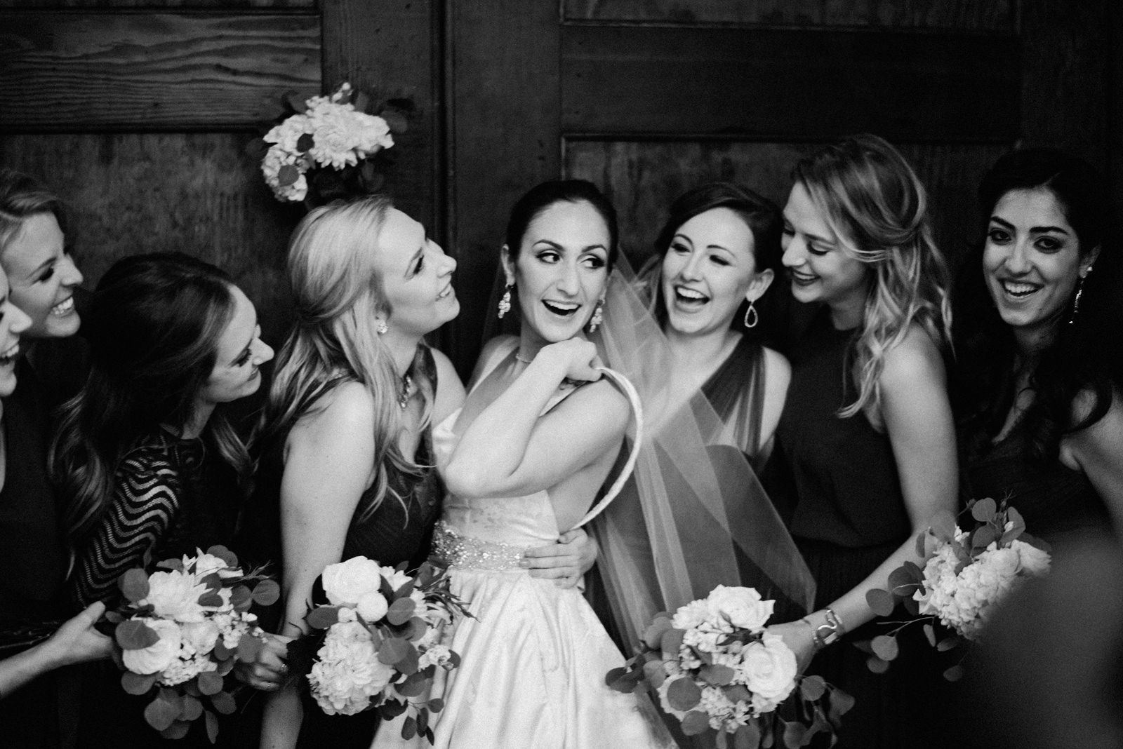 243-bride-and-bridesmaids-laughing-at-sodo-park-by-best-seattle-film-photographer-ryan-flynn.jpg