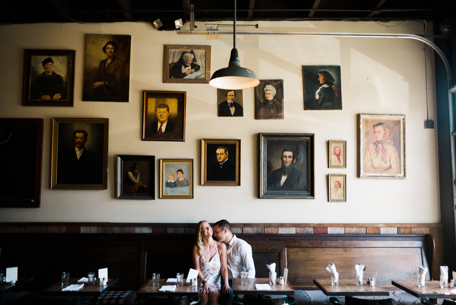 245-hip-indoor-engagement-session-in-seattle-with-paintings-on-wall-by-ryan-flynn.jpg