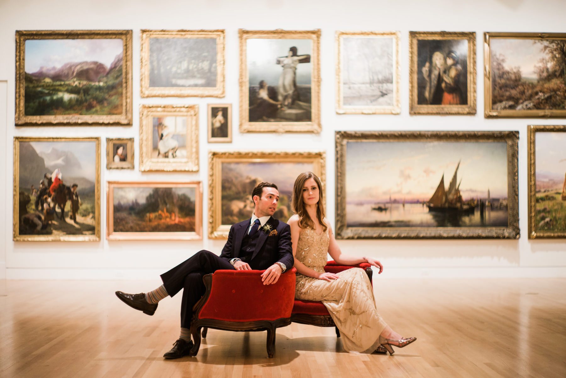 032-couple-sitting-in-lounge-chairs-in-front-of-oil-paintings-at-the-frye-museum.jpg