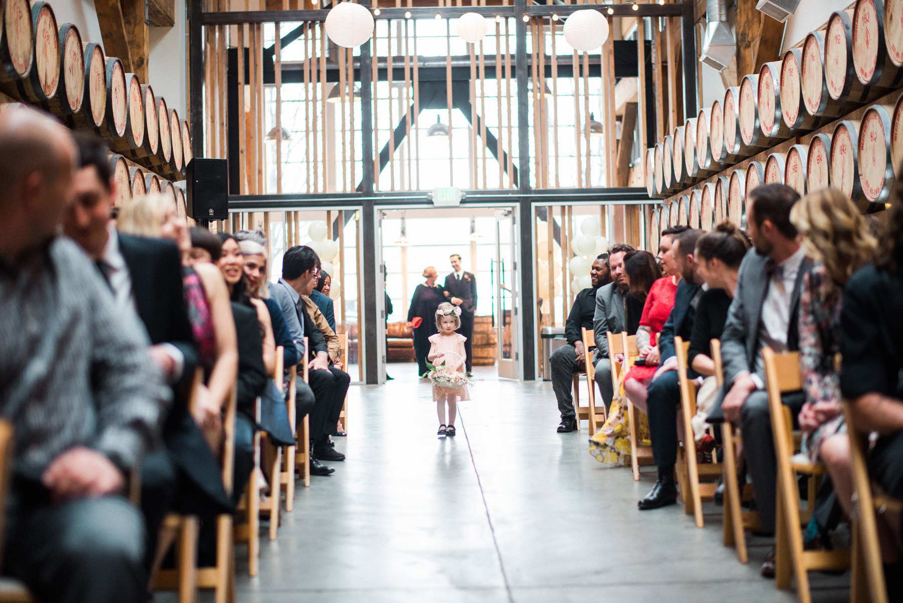 033-wedding-ceremony-among-whiskey-barrels-at-westland-distillery.jpg