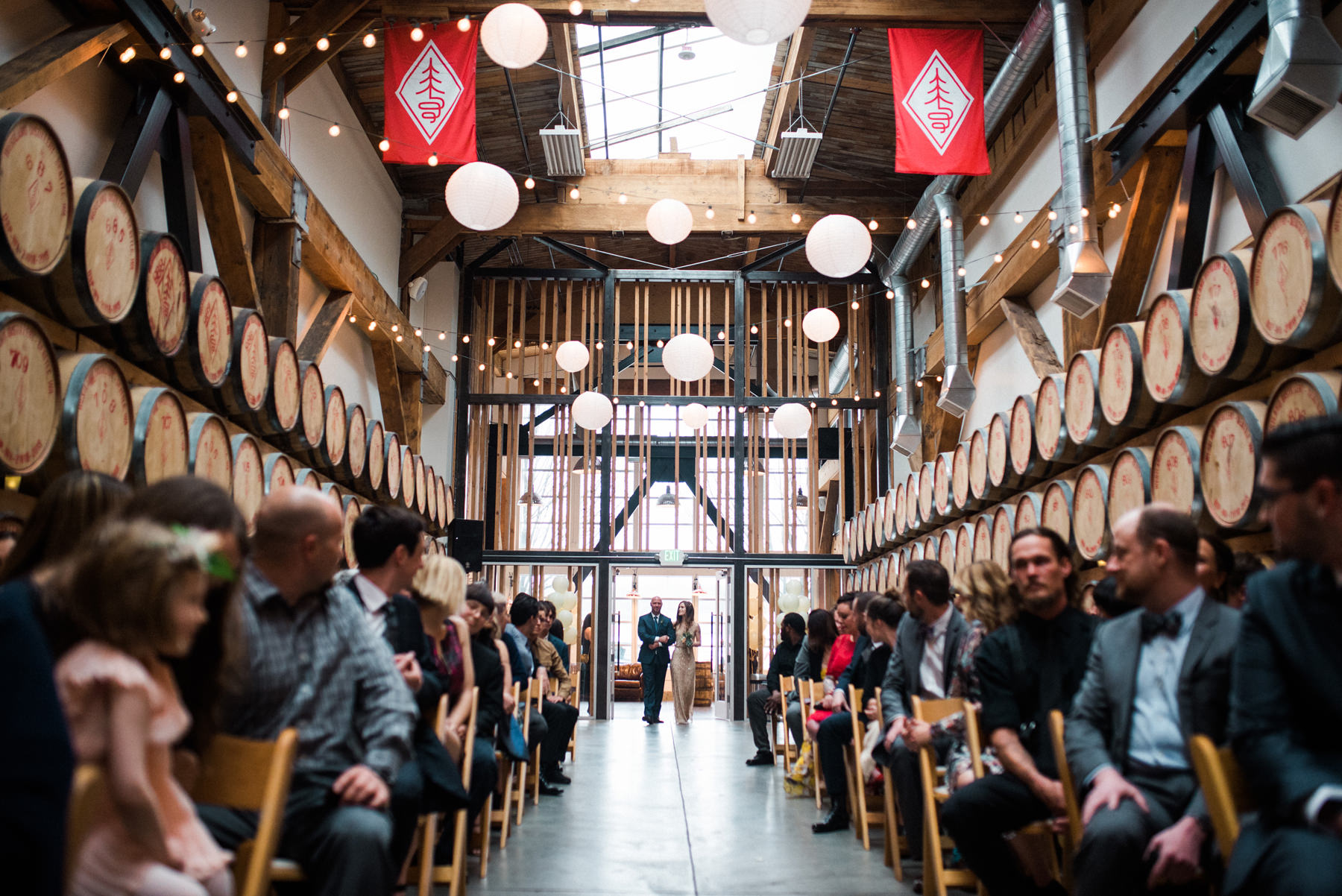036-wedding-ceremony-among-whiskey-barrels-at-westland-distillery.jpg