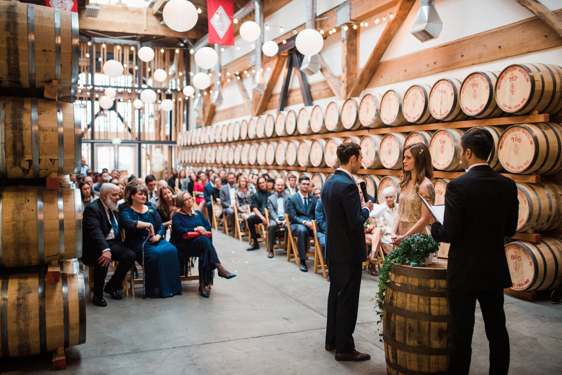 037-wedding-ceremony-among-whiskey-barrels-at-westland-distillery.jpg