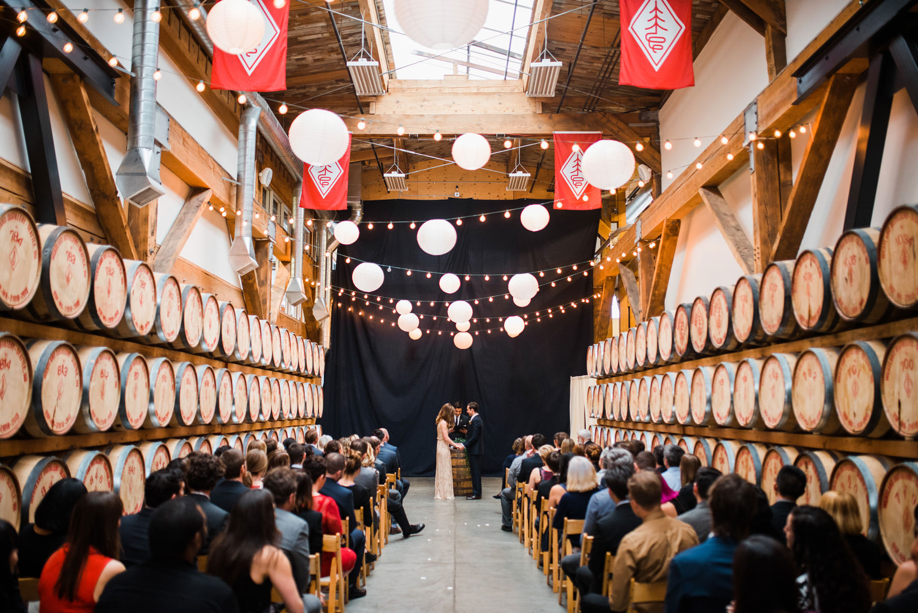 038-wedding-ceremony-among-whiskey-barrels-at-westland-distillery-in-seattle.jpg