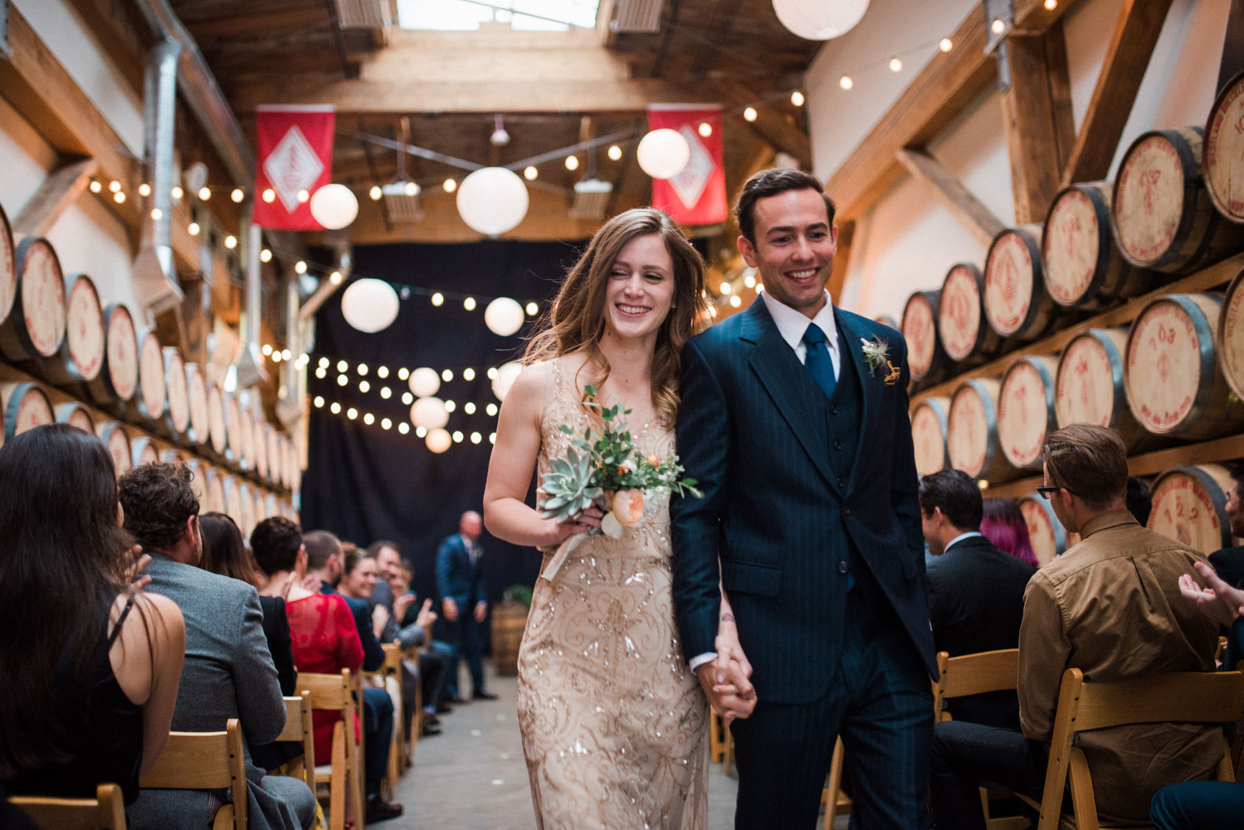045-wedding-ceremony-among-whiskey-barrels-at-westland-distillery-in-seattle.jpg