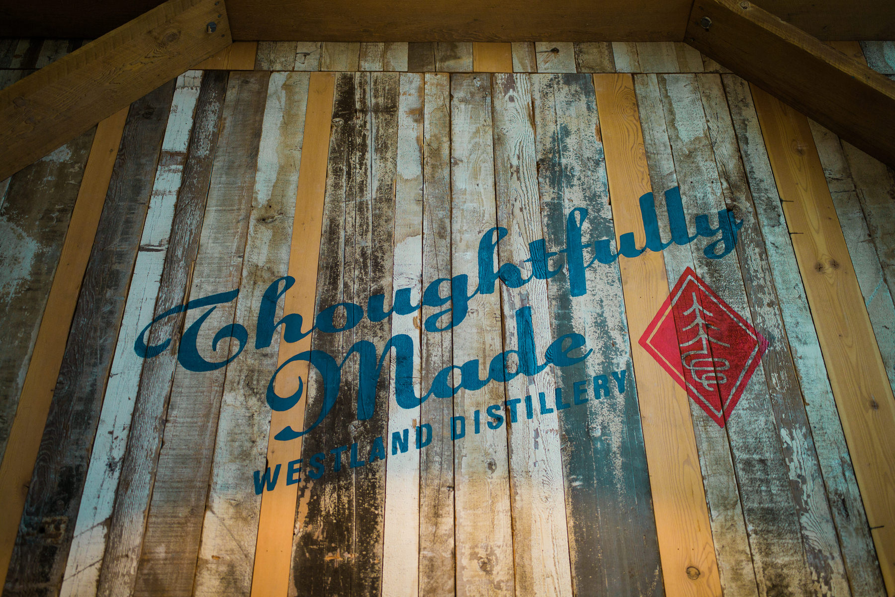 046-hand-painted-sign-on-weathered-reclaimed-wood-at-westland-distillery.jpg