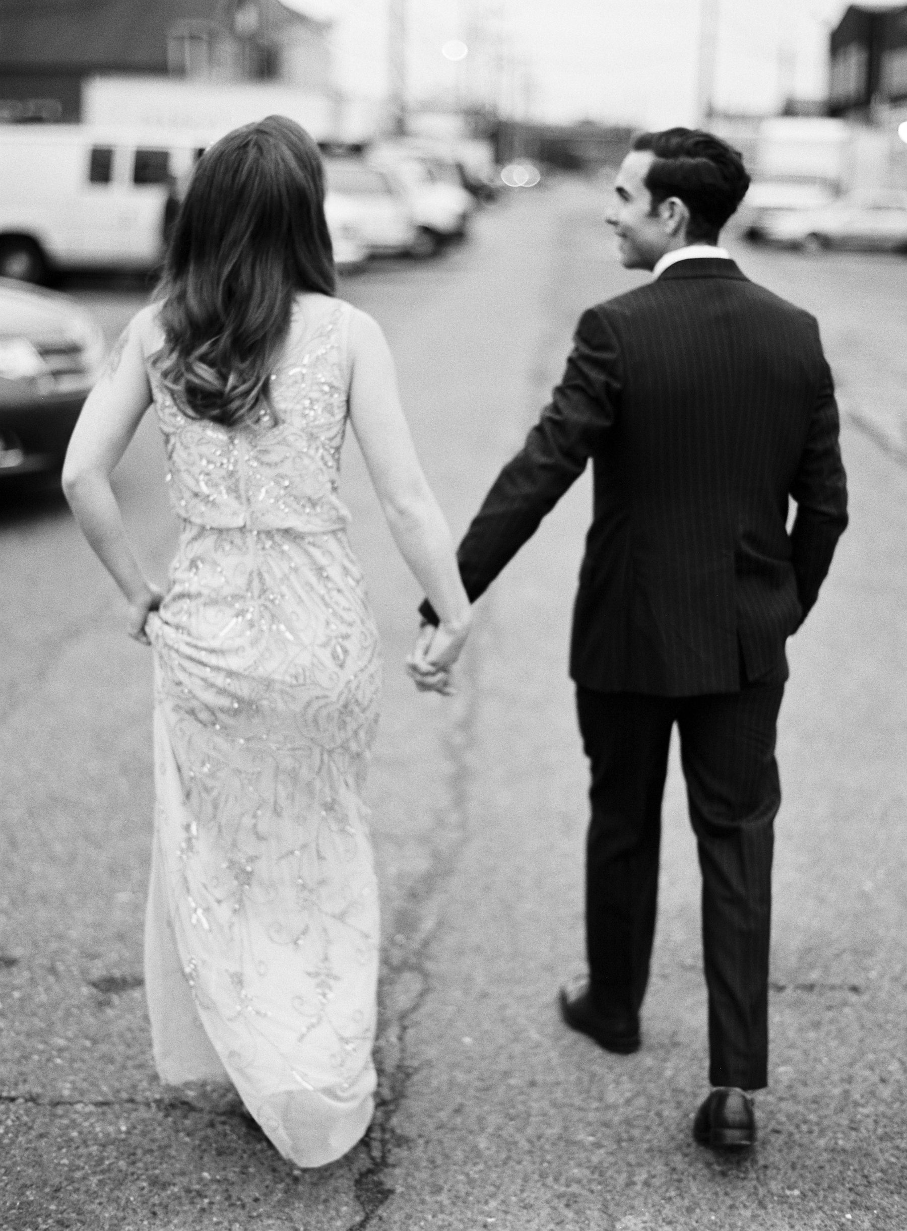 057-bridal-couple-walking-away-on-black-and-white-medium-format-film.jpg