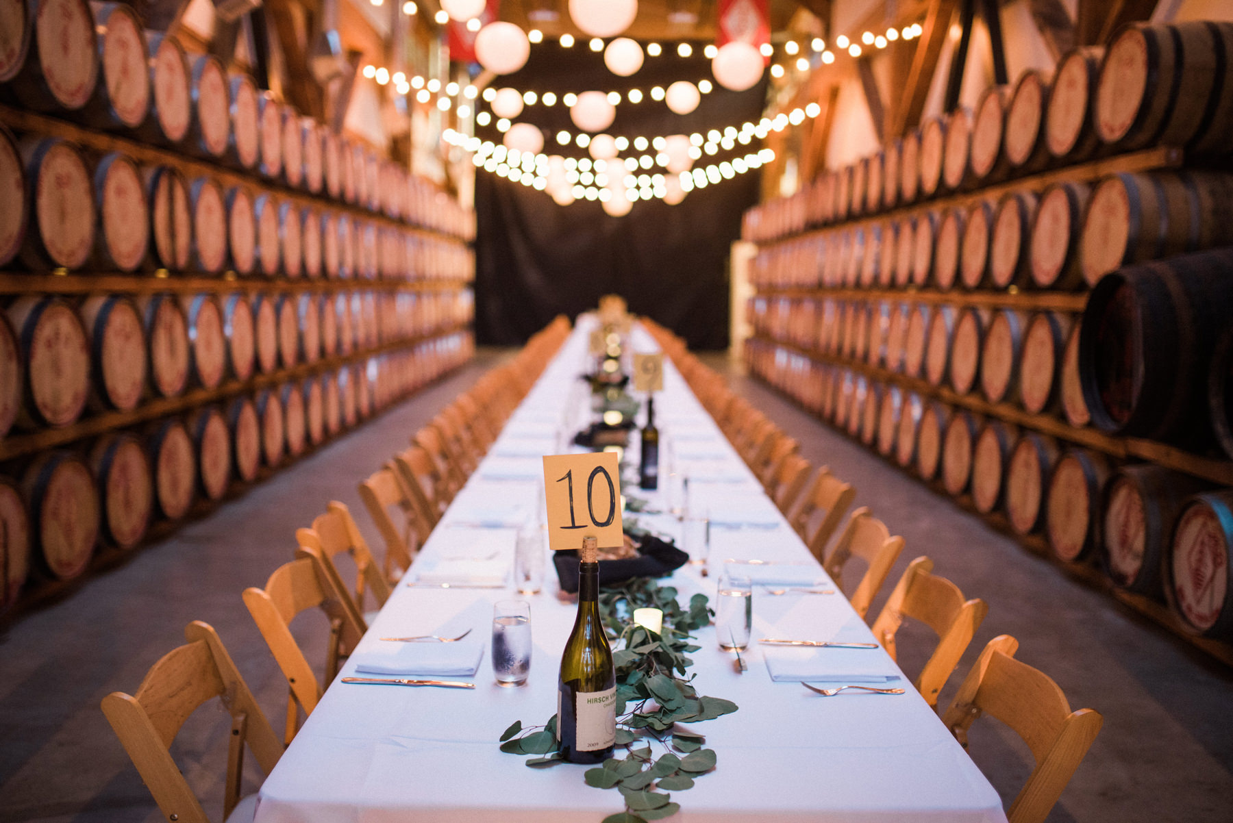 065-long-table-wedding-dinner-under-string-lights-at-westland-distillery.jpg