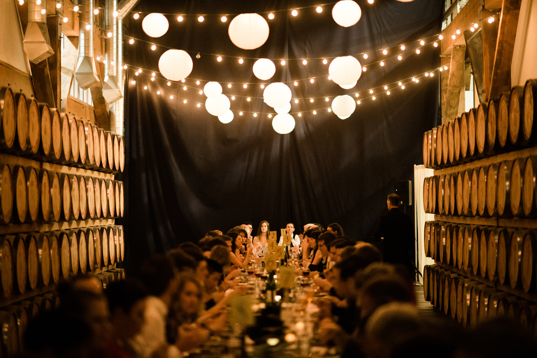 067-long-table-wedding-dinner-under-string-lights-at-westland-distillery.jpg