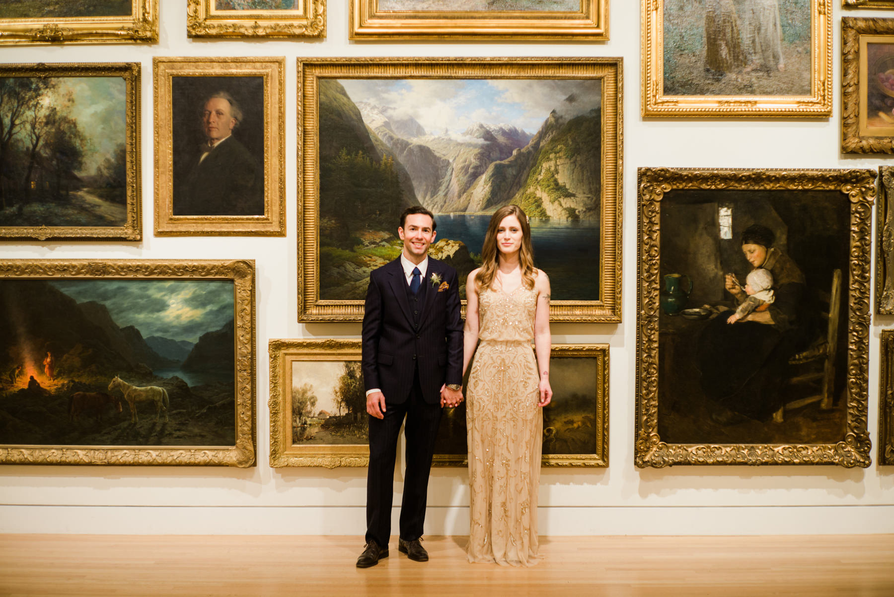 001-hip-bride-and-groom-in-front-of-oil-paintings-at-the-frye-art-museum.jpg