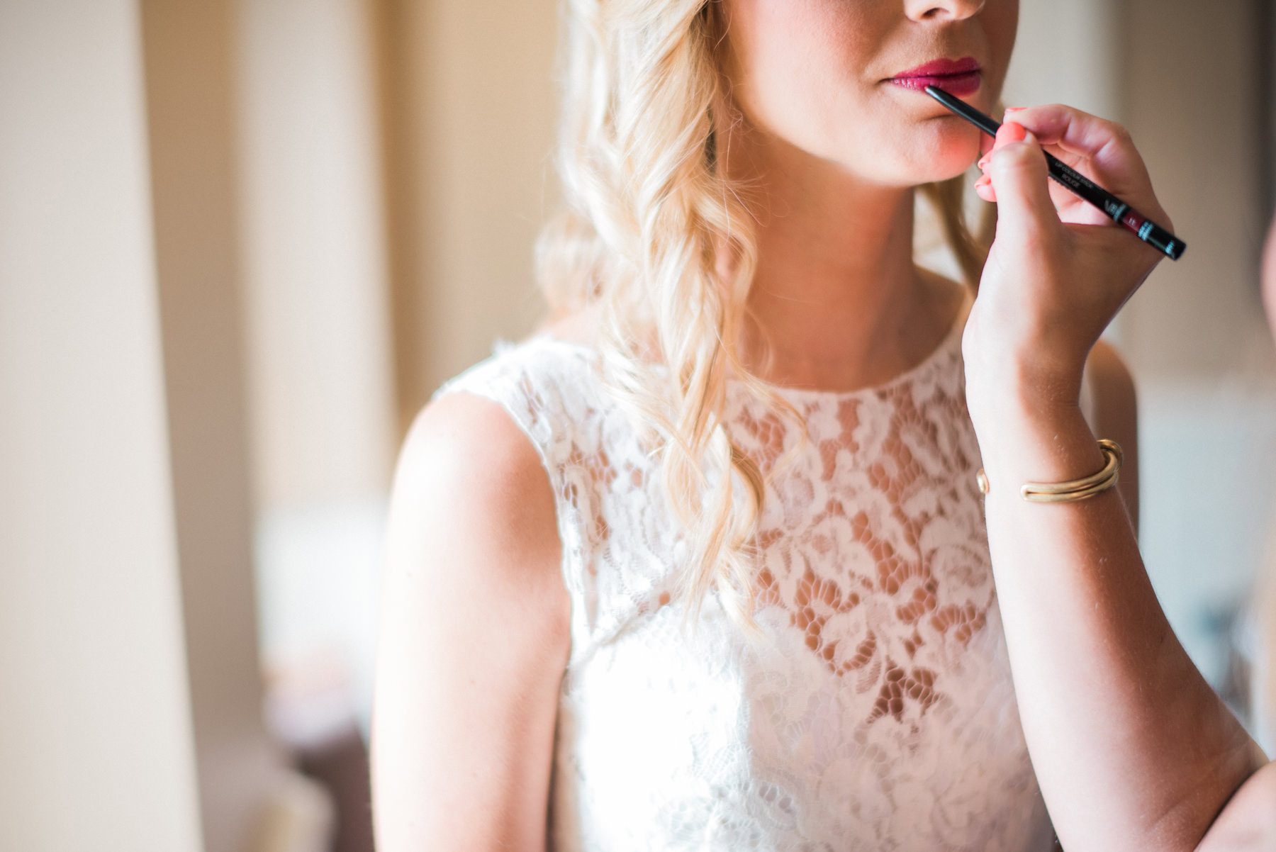 166-close-up-of-bride-getting-lipstick-done.jpg