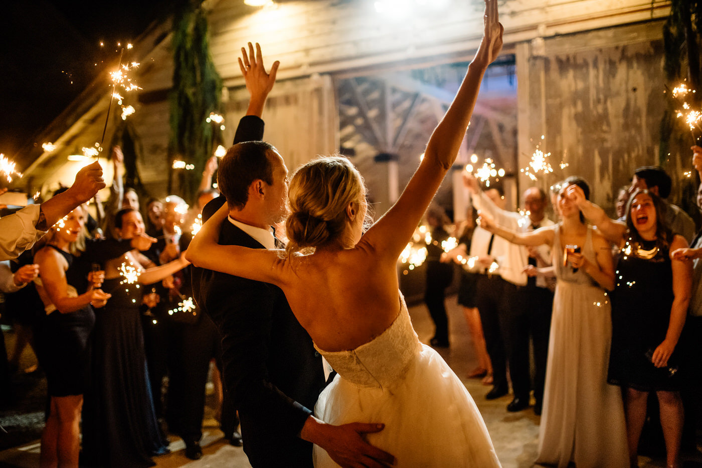 009-joyful-bride-and-groom-during-a-sparkler-exit-at-dairyland.jpg