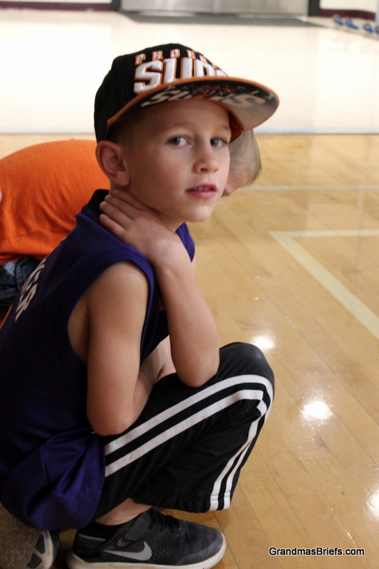 Camden patiently enjoying his big brothers basketball game