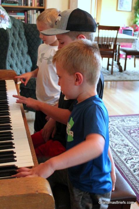 3 boys piano.JPG