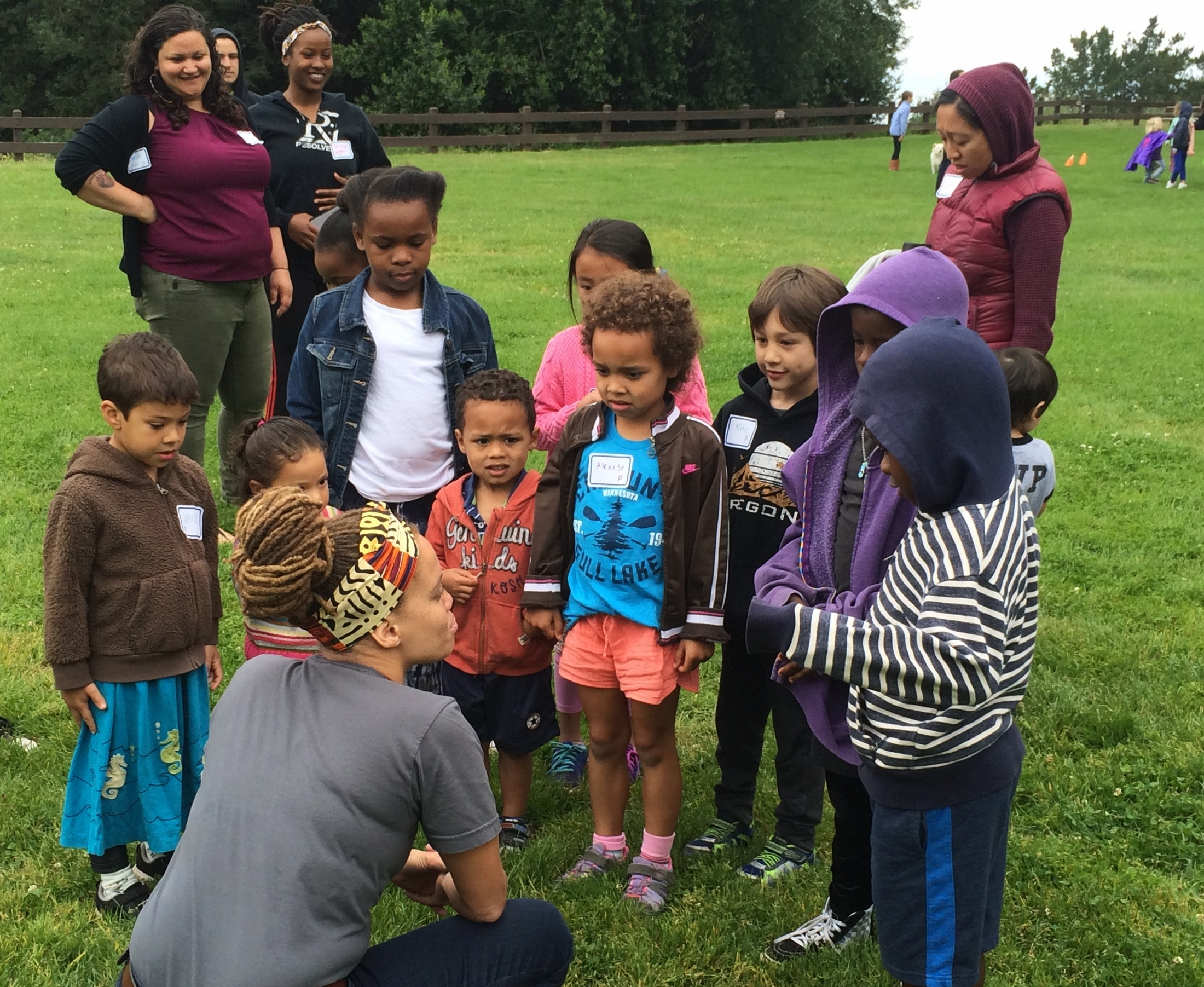 """Shayna Cureton, Director of Abundant Beginnings, engaging in dialogue with children at the May 14th """"Play, Power, and Privilege Teach-In for Children""""."""