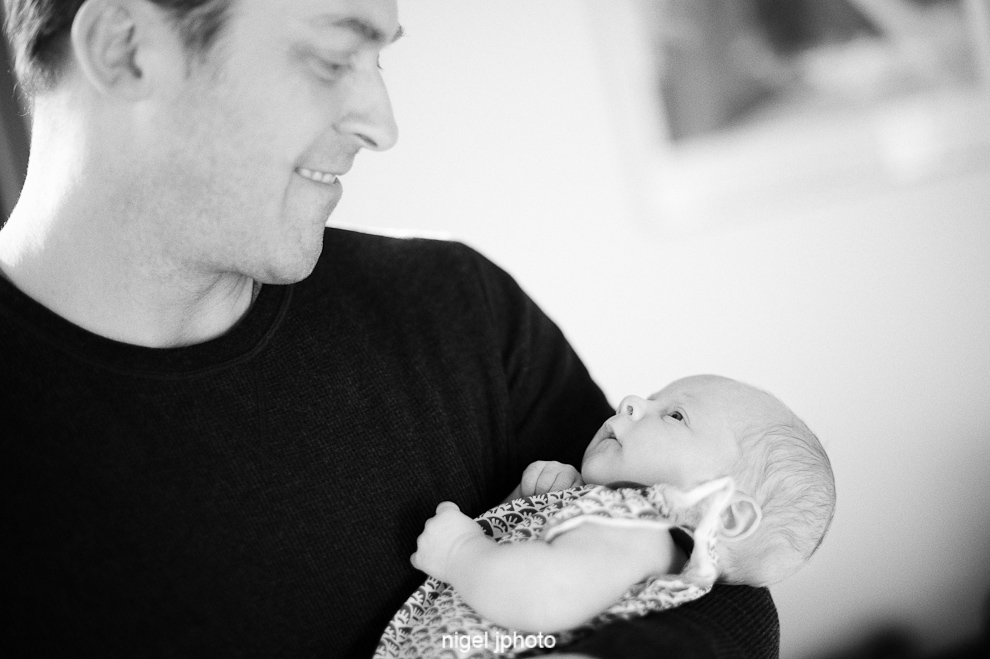 young-father-holding-infant-baby-seattle-portrait.jpg