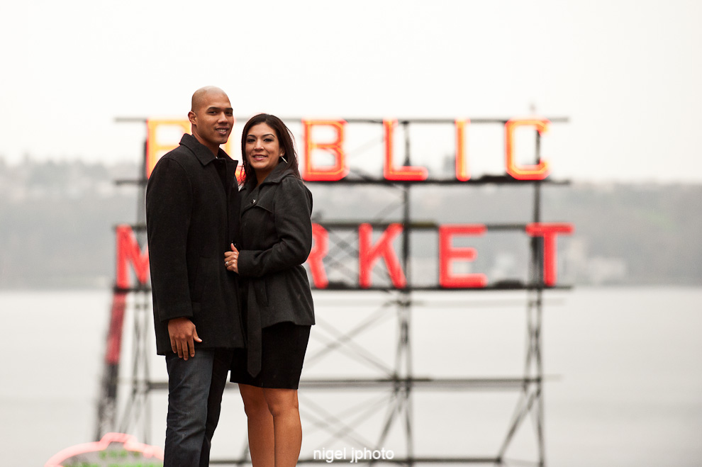 seattle-engagement-photo-public-market-sign-pike-place-latino-couple.jpg
