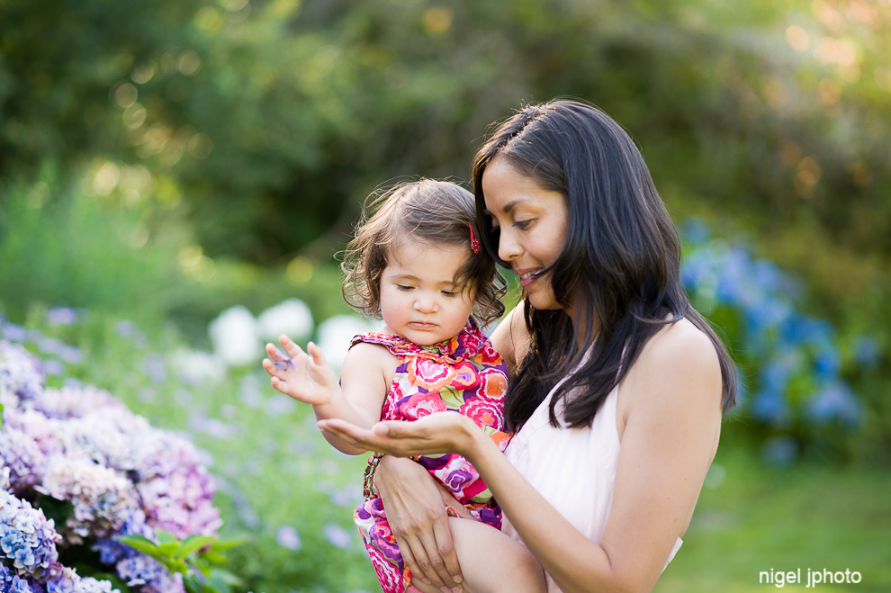 two-year-old-girl-with-mother-holding-flower.jpg