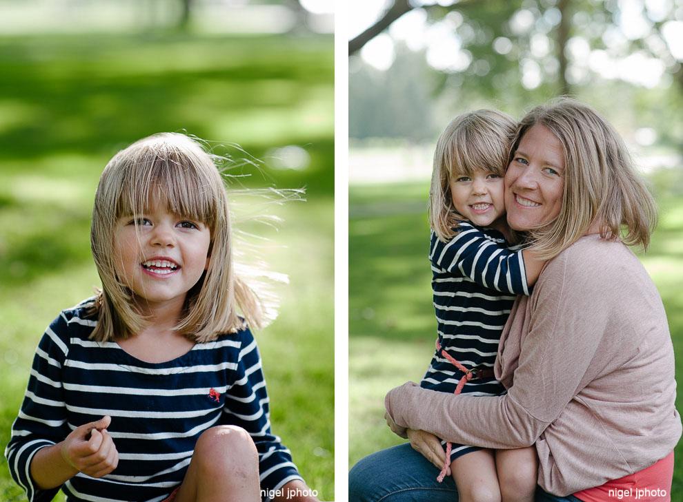 family-photos-seattle-eastside-mom-holding-daughter-in-park.jpg
