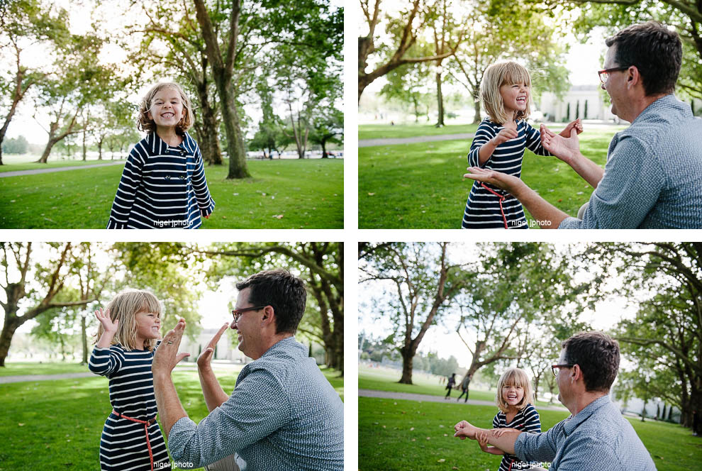 family-photos-seattle-eastside-sisters-playing-with-dad.jpg