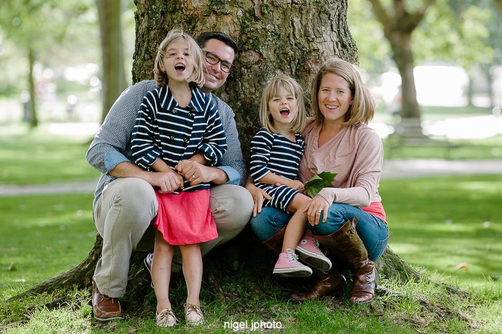 family-photos-seattle-eastside-sitting-tree-happy.jpg