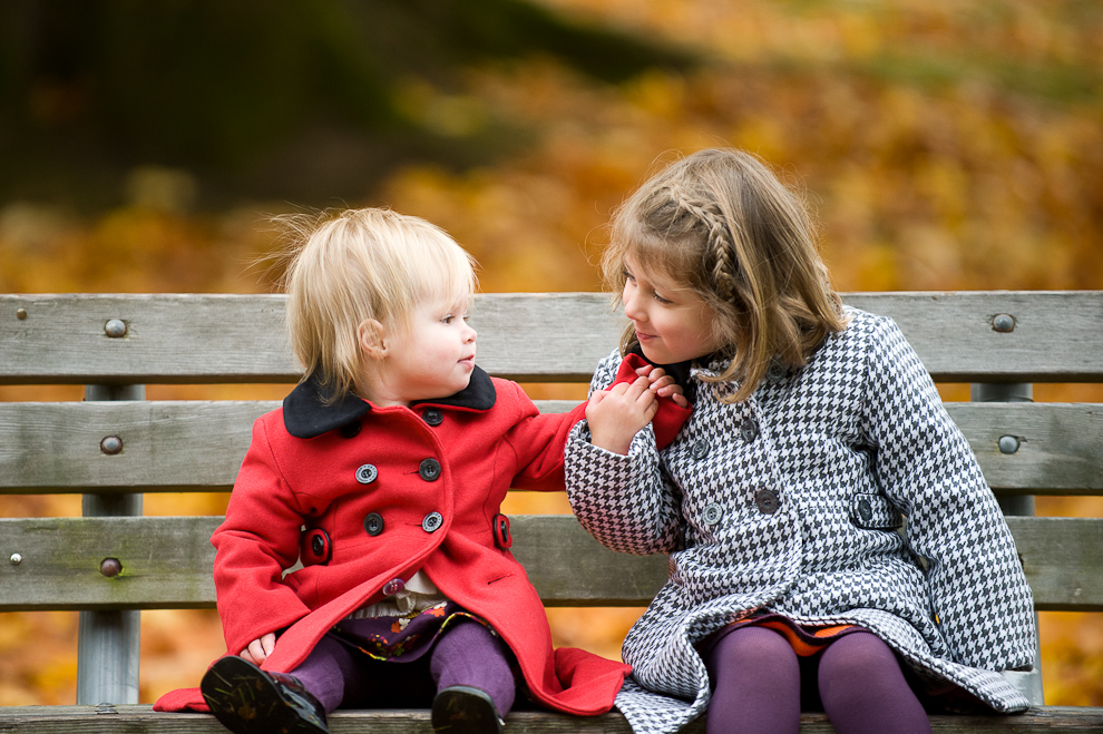 1.2.portrait-sisters-park-bench-fall-leaves-seattle.jpg