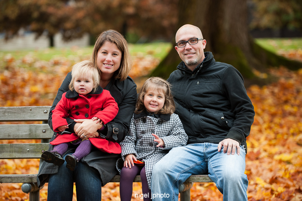 portrait-young-family-two-little-girls-bench-seattle.jpg