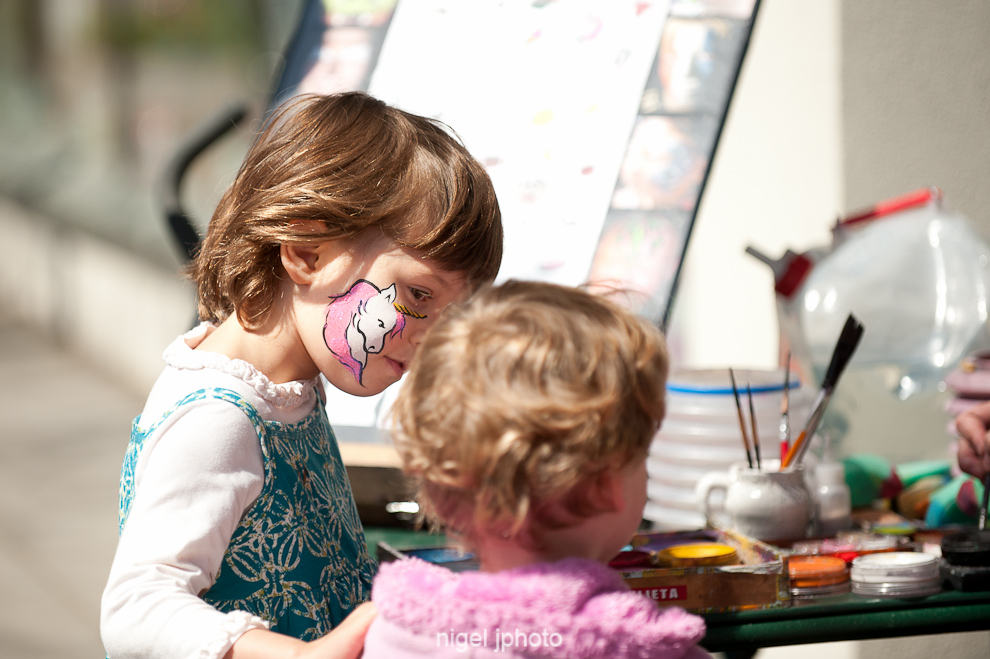 candid-young-sisters-face-paint-ballard-seattle.jpg