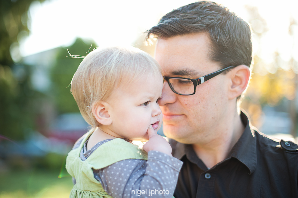 portrait-young-father-toddler-daughters-sun-backlit-seattle.jpg