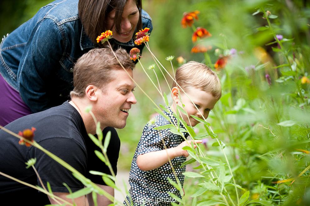 three-year-old-boy-flowers-with-mom-dad-seattle-portrait.jpg