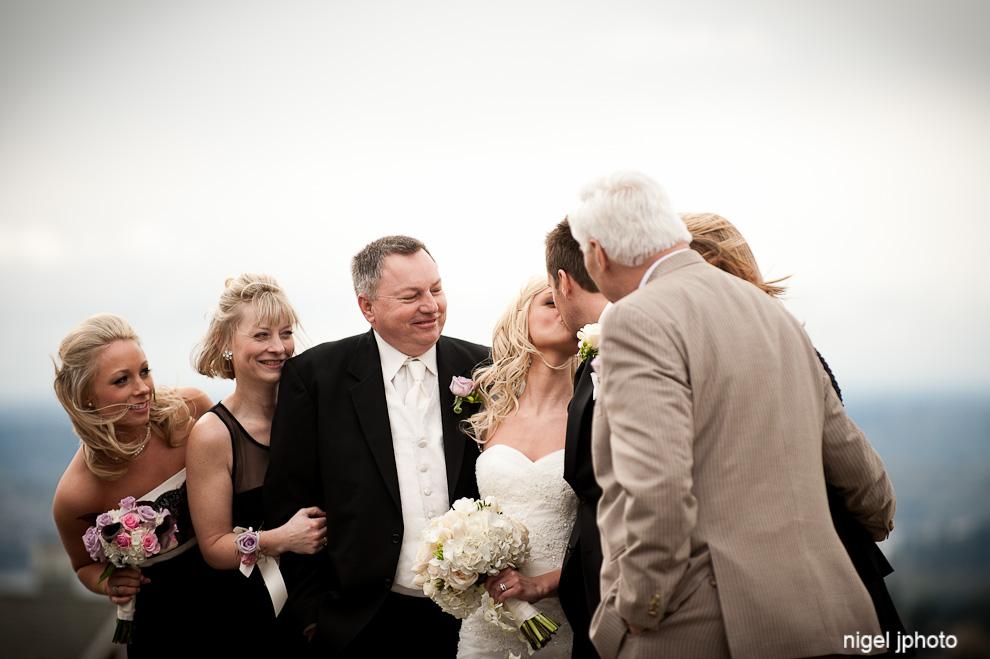 wedding-portrait-of-family-bride-groom-kissing-seattle.jpg