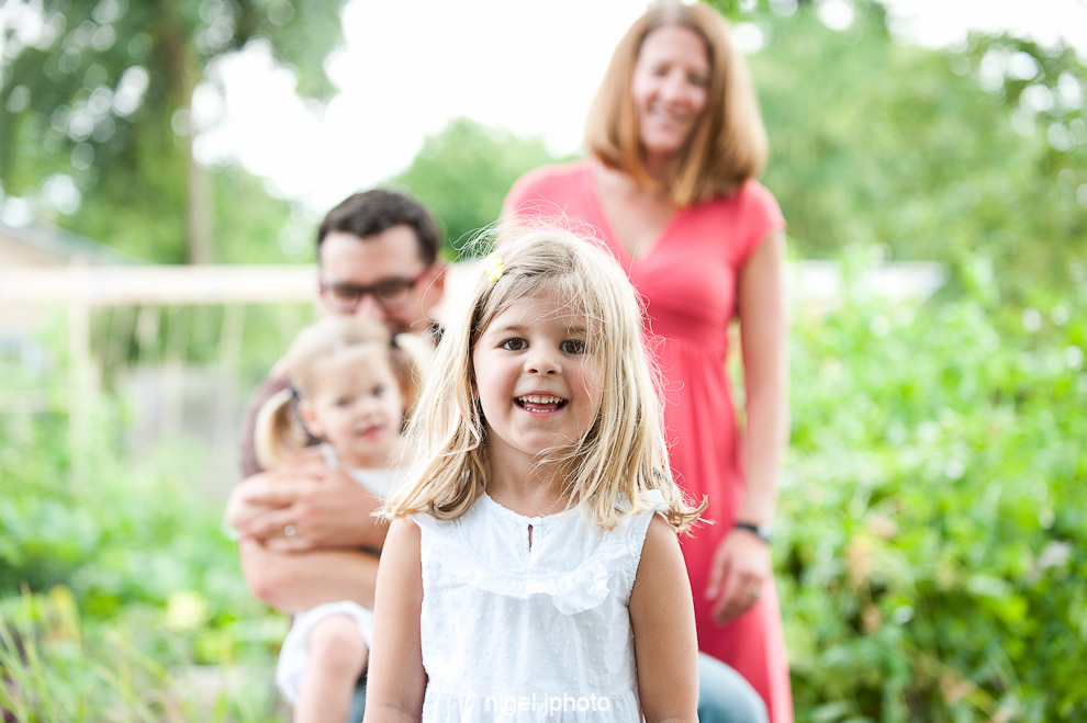 young-family-of-four-in-garden-seattle-portrait.jpg