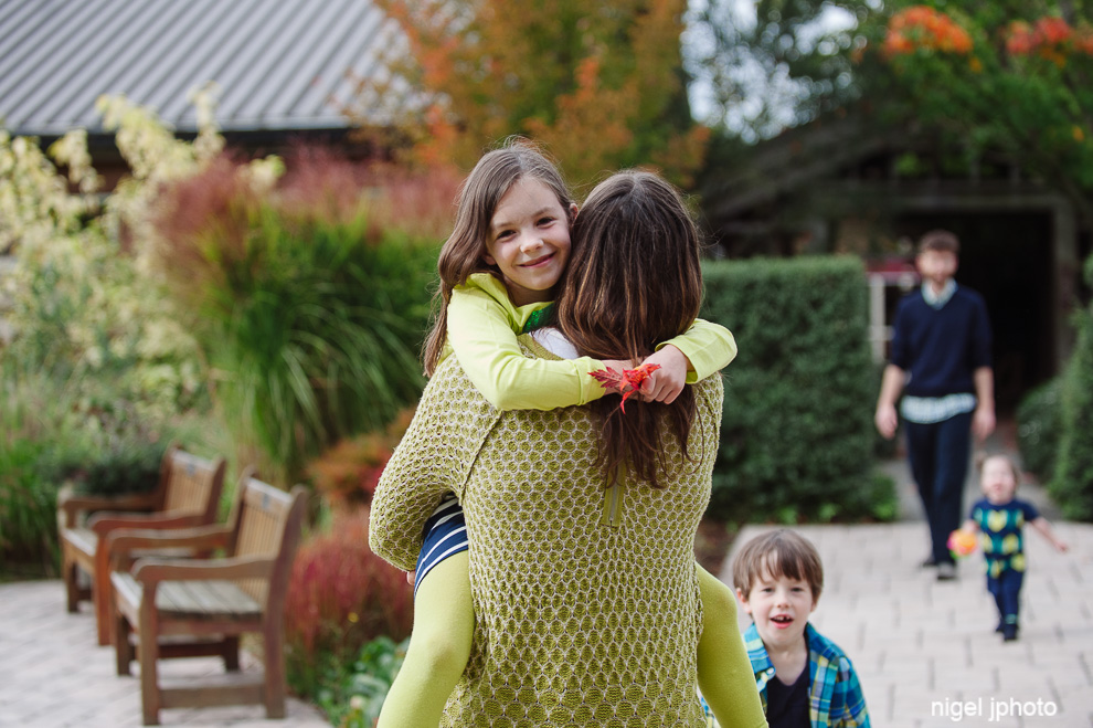 girl-in-mothers-arms-seattle-photography.jpg