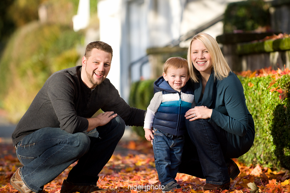 portait-young-couple-with-todler-son-fall-leaves-seattle.jpg