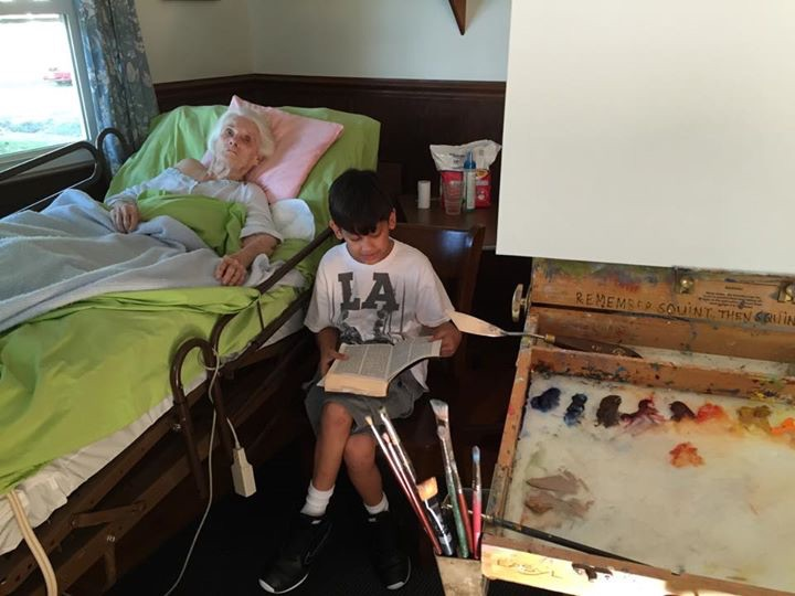 Cole reading the book of Genesis to Grandma as I prepare to paint.