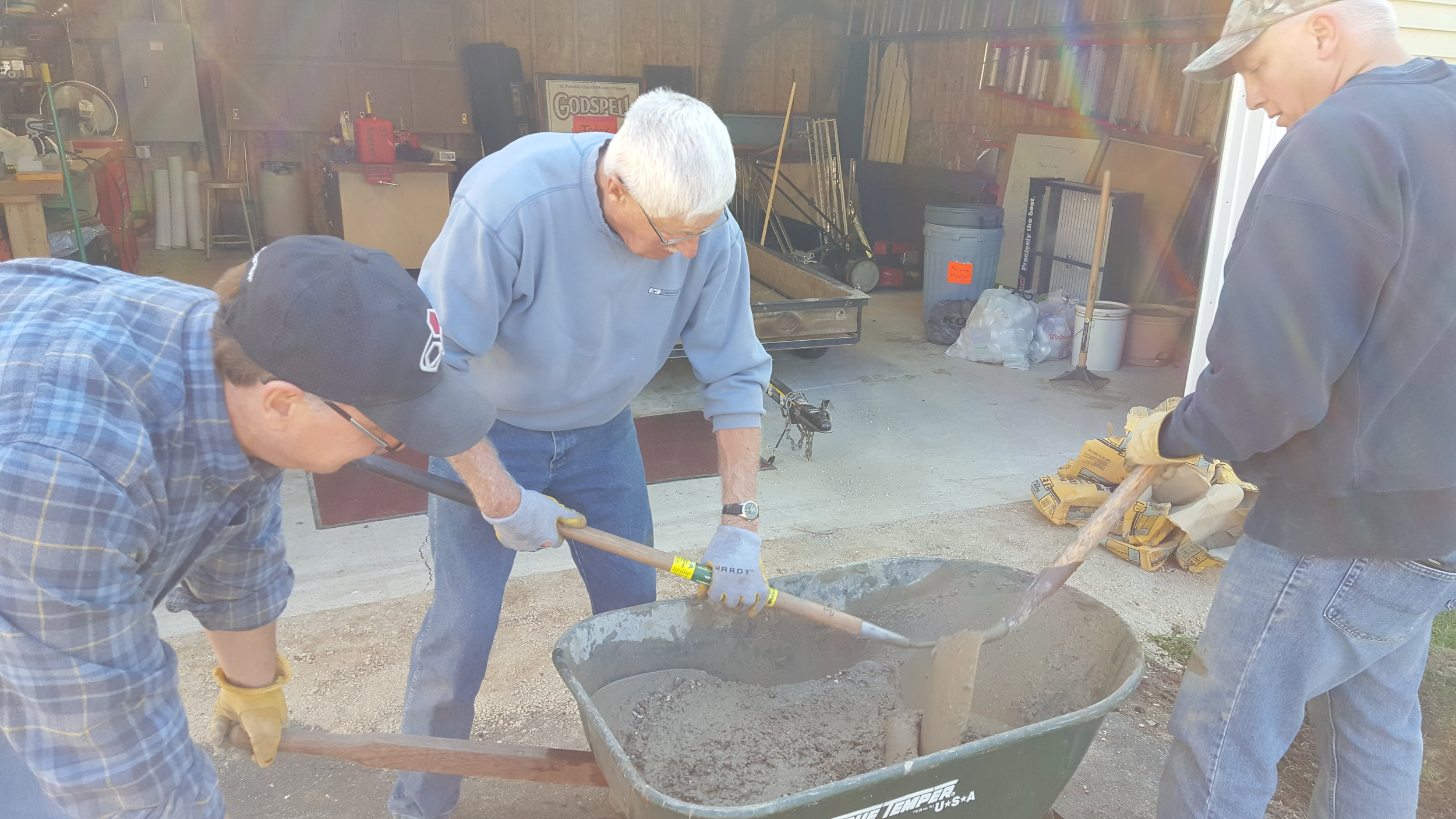 Jim Reinke Ron and Steve Schlze mixing concrete May 6 2017.jpg