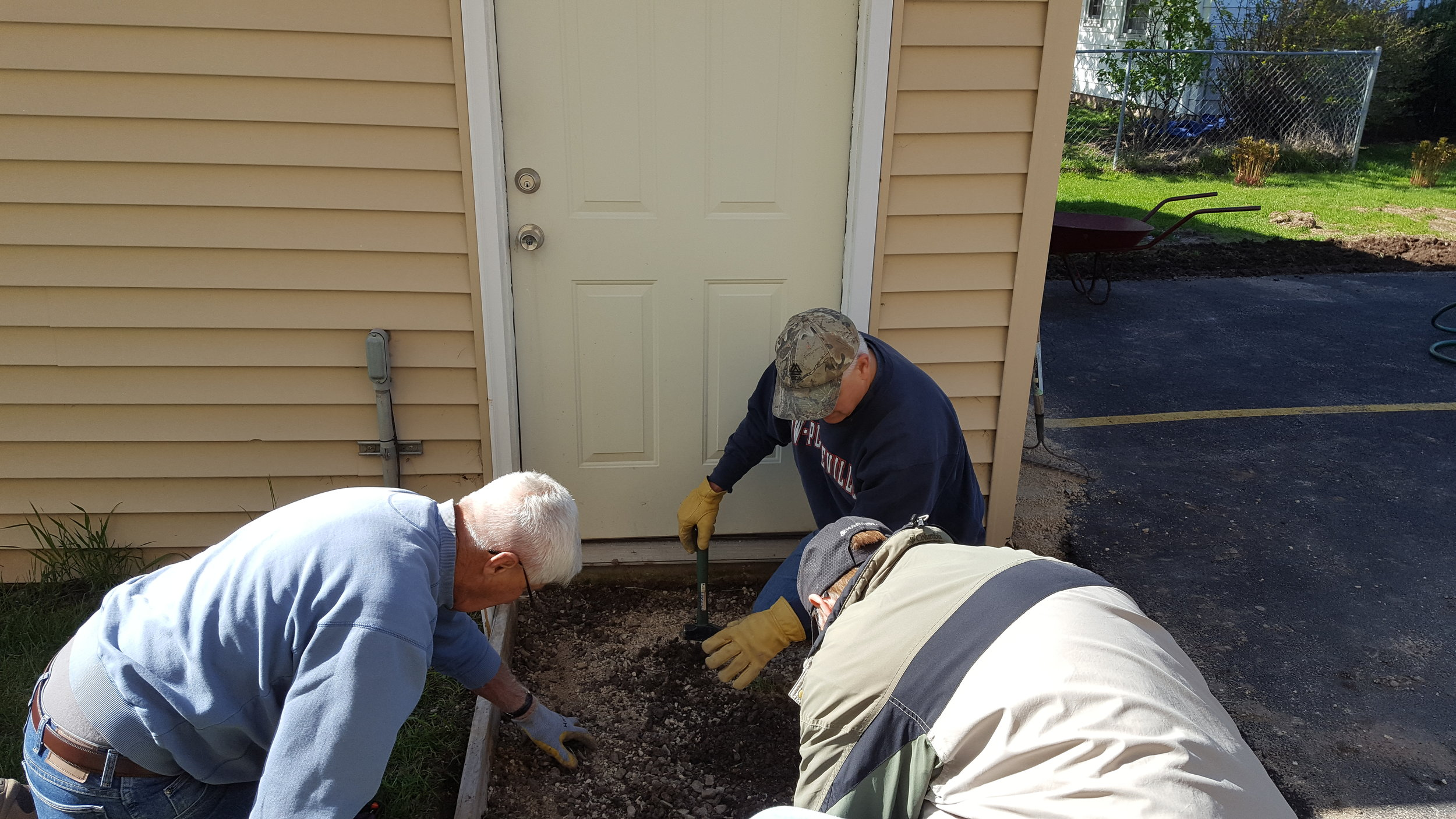 Jim Reinke Ron and Steve Schlze spring cleanup May 6 2017.jpg