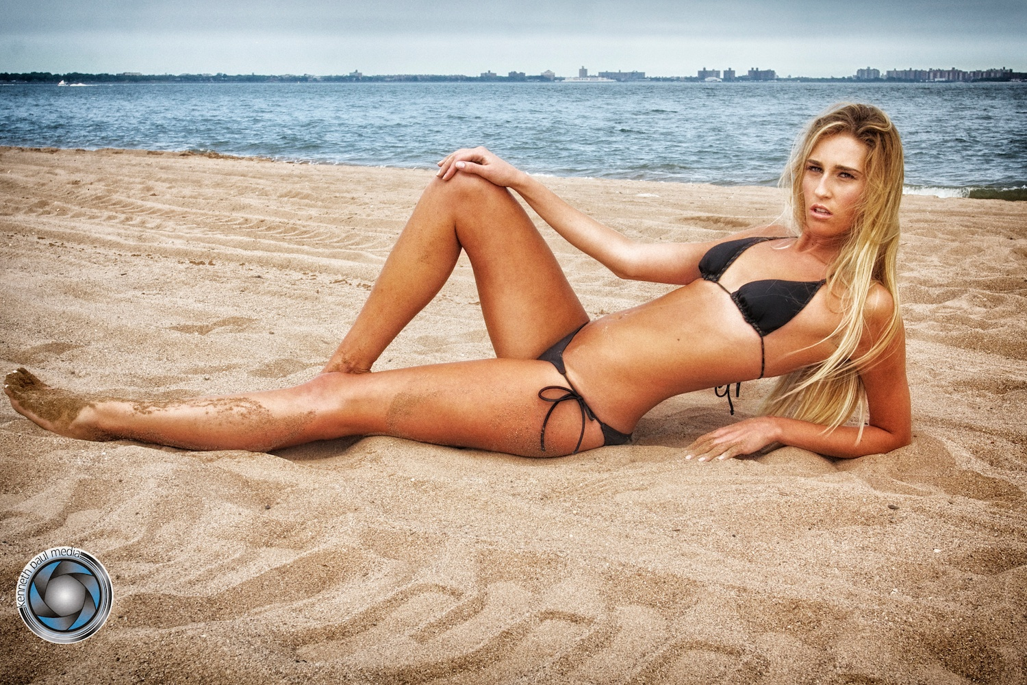 Photographer Portfolio New York New York United States    Promotional model in swimsuit on the beach    Kenneth Paul Media   a  Kenneth Paul Media Studio Production