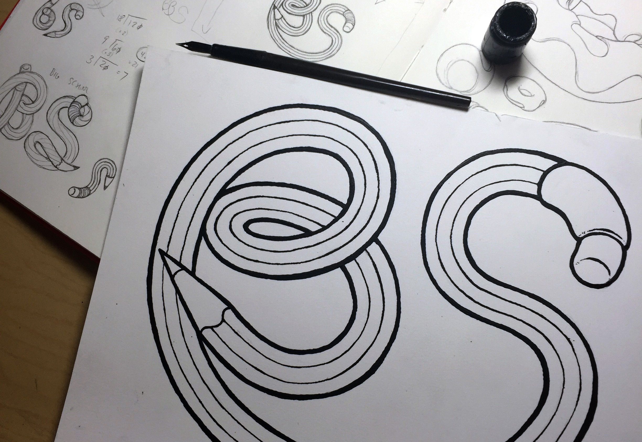 inking the BS logo with sketches behind it