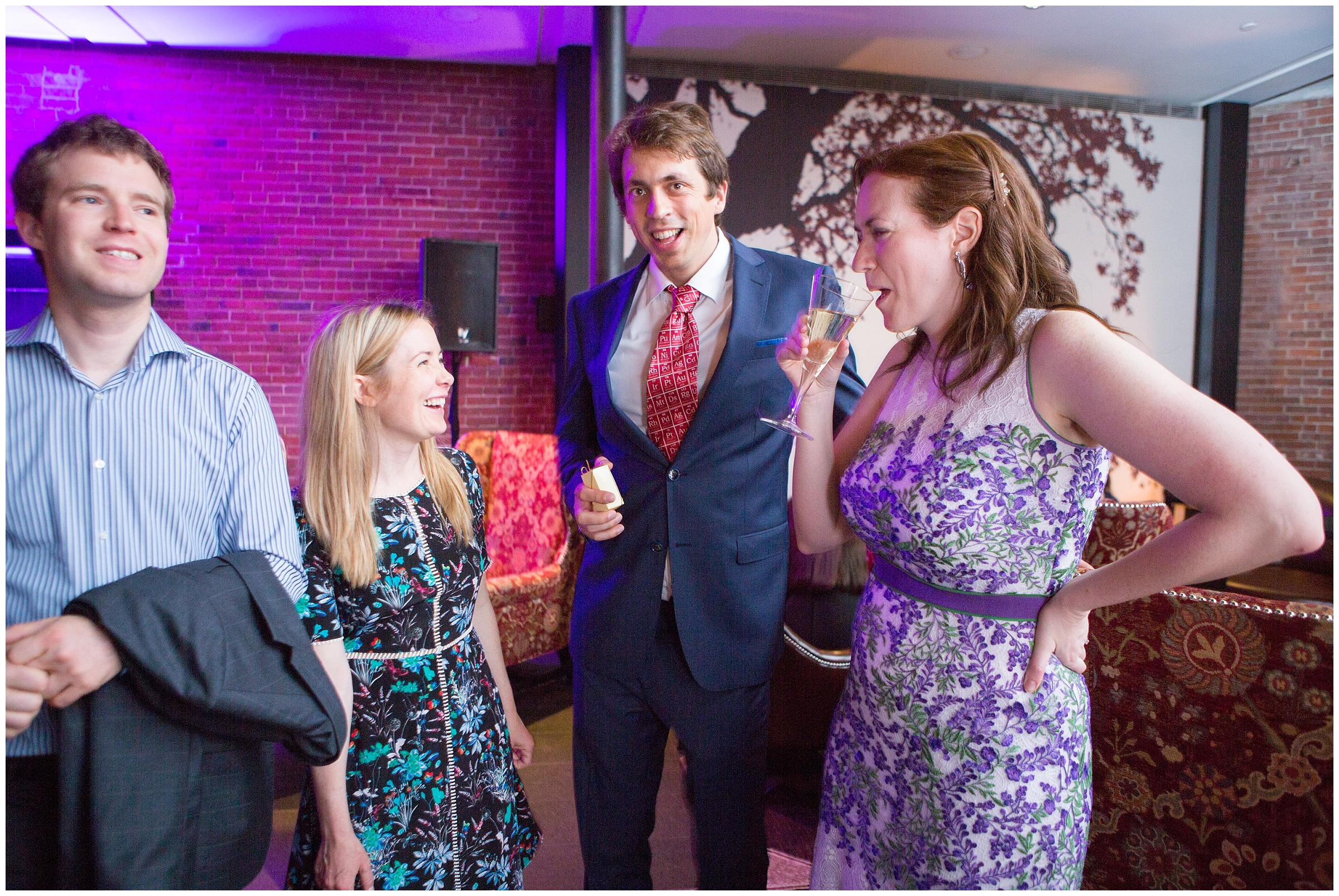 Bride in floral wedding gown commiserates with guests after a fire alarm was triggered and Boston Fire Department gave the all-clear by Ryan Richardson Photography.
