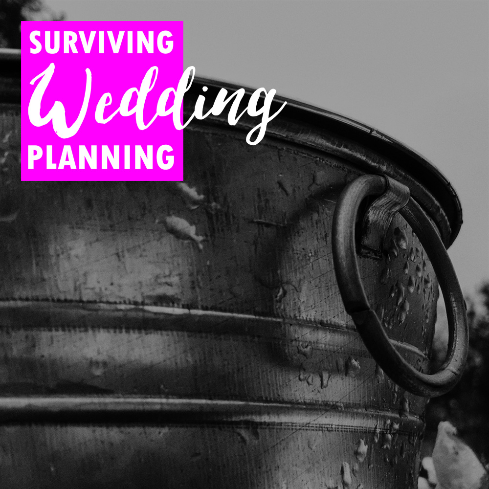 Pictured: A galvanized metal bucket covered in morning dew, perfect for tossing your unwanted wedding decisions into for later consideration.