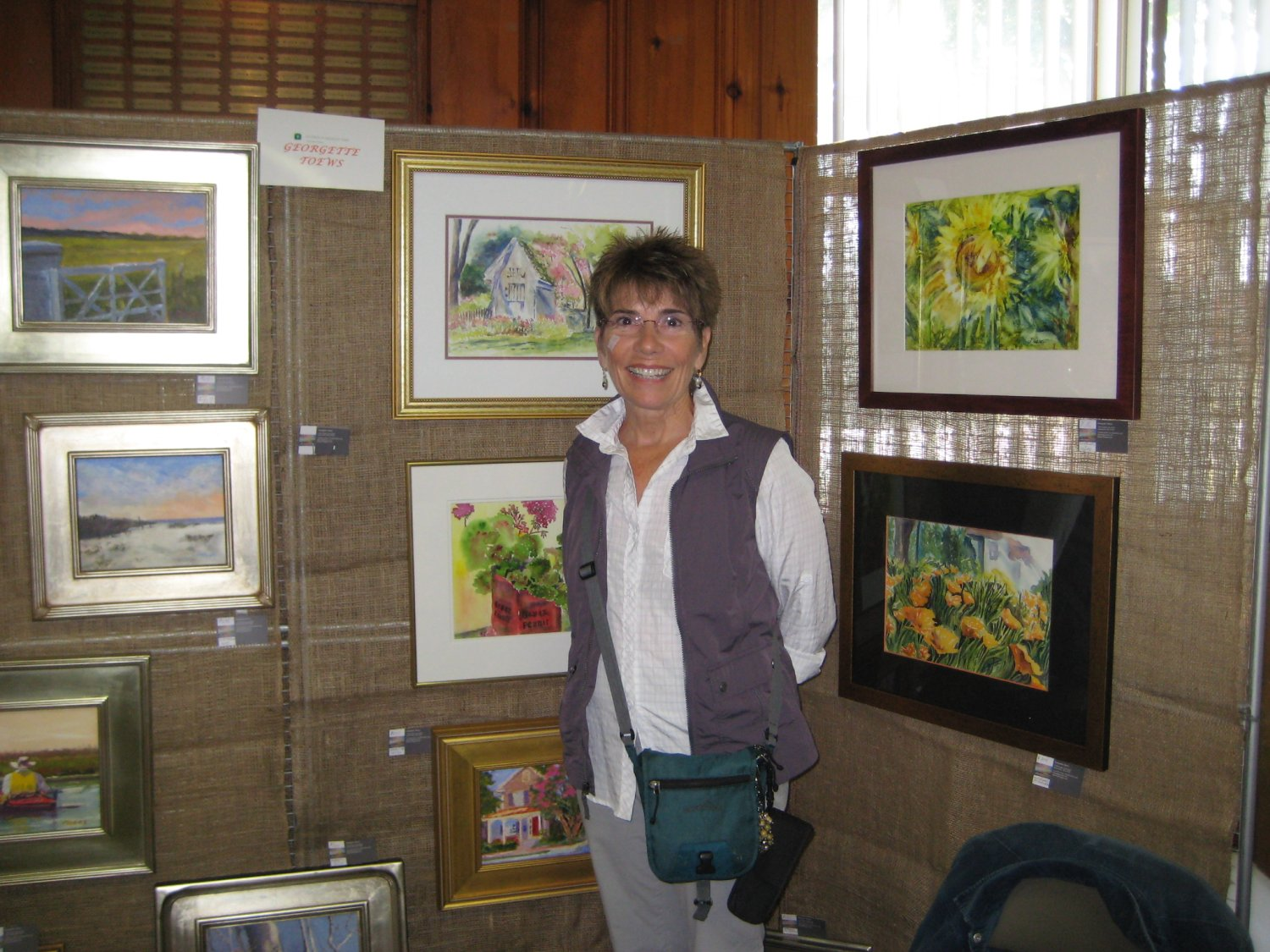 Georgette Toews and her landscapes and paintings.