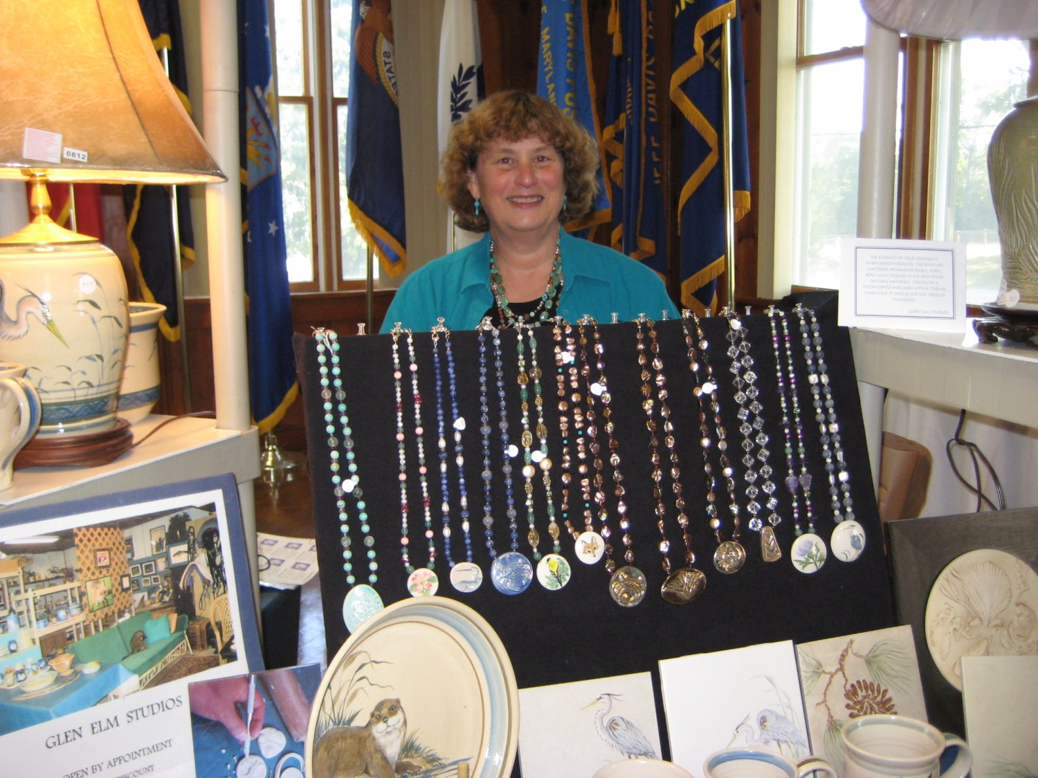 Jean Higgins with her handcrafted pendants.