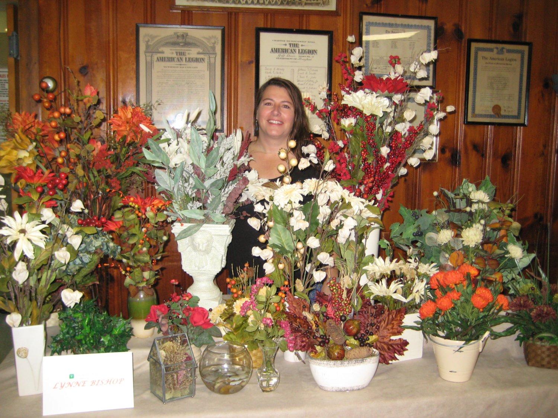 Lynne Bishop shows her beautiful silk flower arrangements.