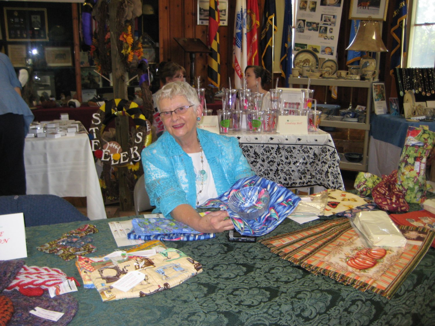 Alice Washburn displays knitted and quilted items, and she kept right on knitting throughout the Fair.